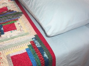 Quilt with sheet